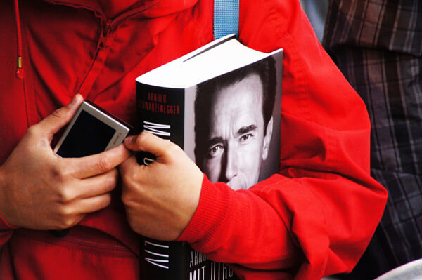 Fan with copy of Schwarzenegger's biography - copyright Nikita Gavrilovs http://www.flickr.com/photos/49913543@N03/