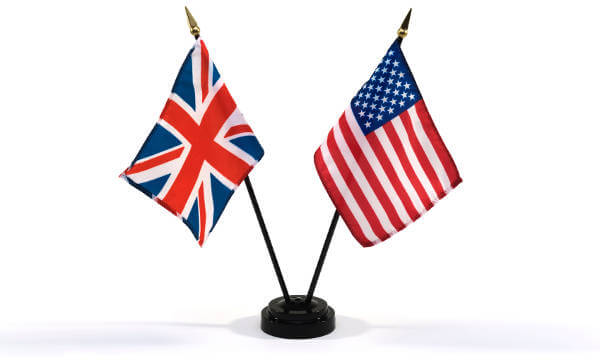 Small British and American flags in a stand
